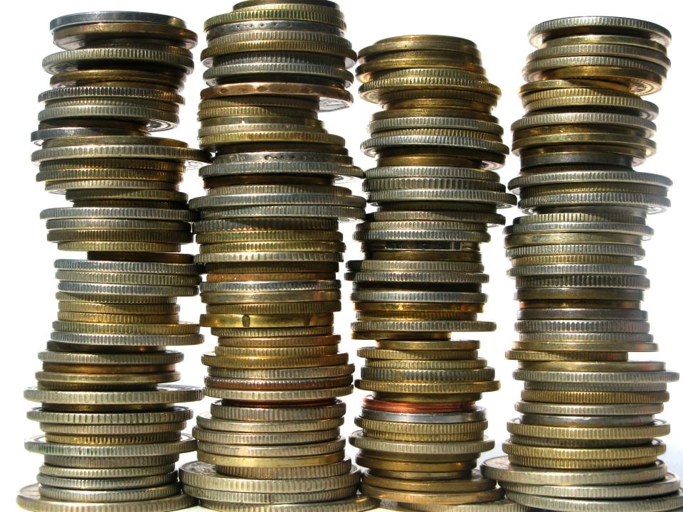 Peníze - mince ve sloupečcích